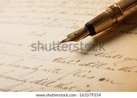 Fountain pen on an antique handwritten letter Royalty-Free Stock Photo #163379354