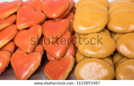 Heart-shaped and round-shaped cream pastries in a dessert tray on white background #1633893487
