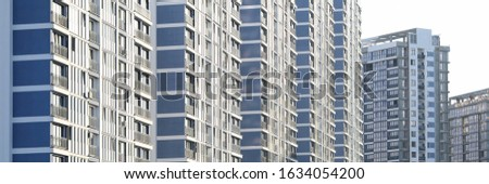 Architecture of city with modern design. Facade of construction for people to live. Exterior of apartments or renovation in town. Structure with lots of floors #1634054200