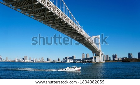 Rainbow Bridge and the landscape of waterfront metropolis, Tokyo in Japan                               #1634082055