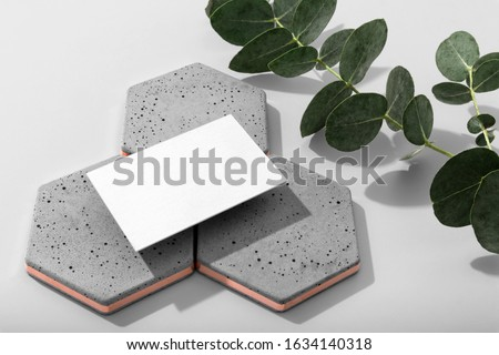 Real photo, stationery business cards branding mockup template to place your design, isolated on light grey background, with concrete, copper, granite and floral elements.