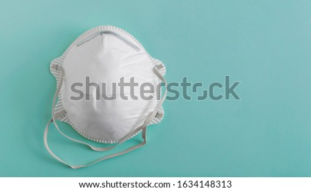 White medical mask isolated. Face mask protection against pollution, virus, flu and coronavirus. Health care and surgical concept. Royalty-Free Stock Photo #1634148313