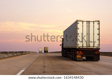 White Truck on highway road with  container, transportation concept.,import,export logistic industrial Transporting Land transport on the asphalt expressway #1634148430