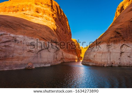 Antelope Canyon. Grandiose cliffs - red sandstone outcroppings. Tour on a pleasure boat on an artificial reservoir Lake Powell. The Colorado River, USA. Concept of active and photo tourism #1634273890