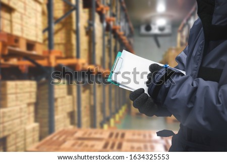 QC. worker checking goods on delivery in the cold room warehouse., Logistics food and beverage in cold storage concept Royalty-Free Stock Photo #1634325553
