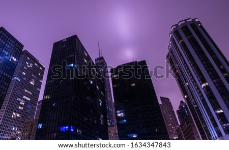 View of Chicago skyscrapers at night with overcast sky