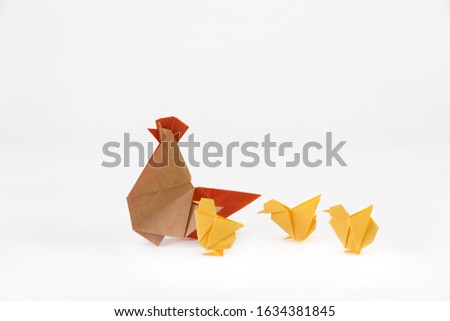 Origami rooster and chicken on a white background