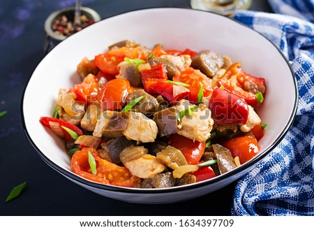 Chicken stir fry. Meat stew with vegetables sweet pepper, onion, tomato, eggplant  in soy sauce gravy. Ketogenic diet. #1634397709