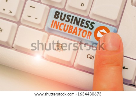 Writing note showing Business Incubator. Business photo showcasing company that helps new and startup companies to develop. #1634430673