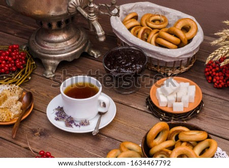 Russian tea. Tea ceremony with a samovar. Ivan tea with honey, with bagels on a dark wooden background. Spring, Shrovetide. Russian traditions. #1634467792