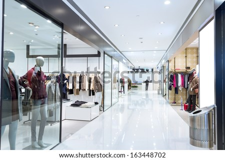 Boutique display window with mannequins in fashionable dresses  Royalty-Free Stock Photo #163448702
