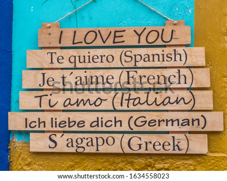Wooden tablets with the word 'I love you' in different languages hang on the street in Bogota. Columbia. Valentine's Day. South America