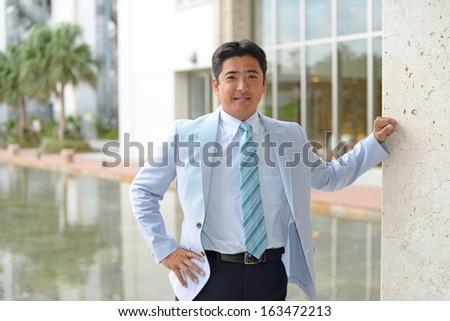 Smiling Asian businessman #163472213