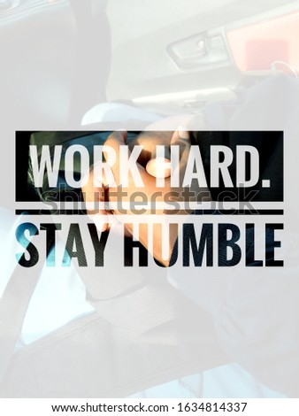 Inspirational life motivating quotes on human hand background. Work hard stay humble #1634814337