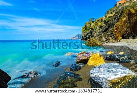 Mountain sea rocky beach view.  Mountain sea beach scene. Rocky sea beach #1634817751