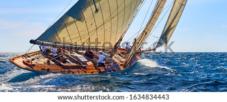 Classic yacht under full sail at the regatta. Sailing yacht race #1634834443