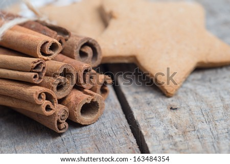 Gingerbread cookies on wooden background with cinamon #163484354