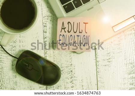 Word writing text Adult Education. Business concept for educational programs for adults who are out of school Trendy metallic laptop blank sticky note coffee cup mouse lying vintage. #1634874763