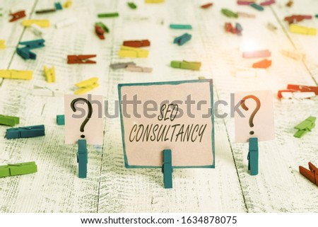 Text sign showing Seo Consultancy. Conceptual photo specialize in evaluating an organization website Scribbled and crumbling sheet with paper clips placed on the wooden table.