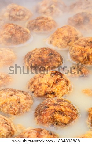 Cooked deep-fried meatballs made from cooked pork and cooked rice.Chinese food. #1634898868