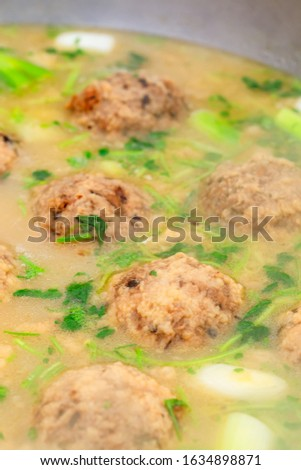 Cooked deep-fried meatballs made from cooked pork and cooked rice.Chinese food. #1634898871