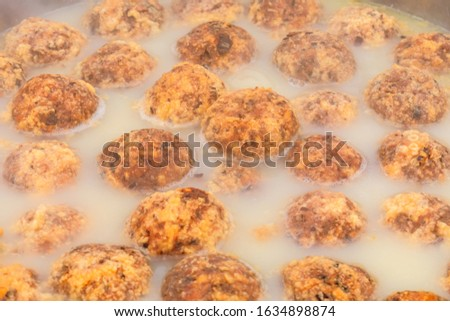 Cooked deep-fried meatballs made from cooked pork and cooked rice.Chinese food. #1634898874
