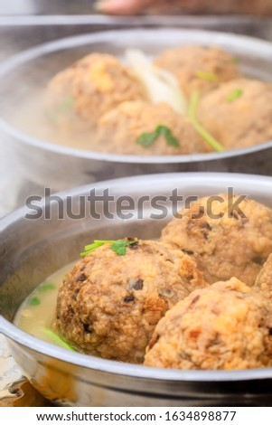 Cooked deep-fried meatballs made from cooked pork and cooked rice.Chinese food. #1634898877