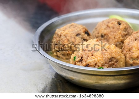 Cooked deep-fried meatballs made from cooked pork and cooked rice.Chinese food. #1634898880