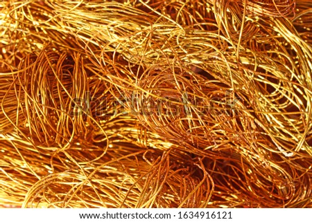 The texture of a heap of copper wire. Conductive metal electrical cable. Scrap metal and secondary raw materials. #1634916121