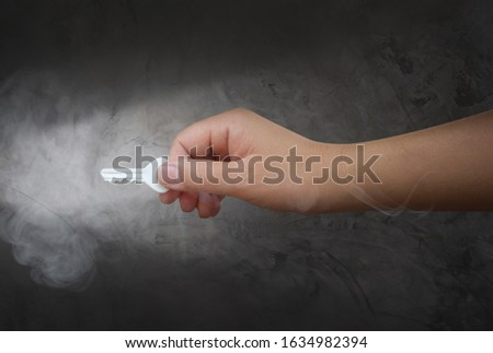 Human hand inserting key for unlocking success.Business success concept. #1634982394