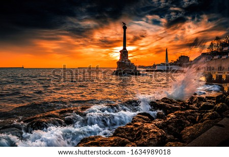 Sunset at mountain sea city. Sunset Black sea in Sevastopol, Russia. Sunset sea in Sevastopol. #1634989018