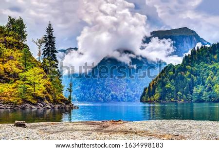 Mountain lake shore landscape. Mountain lake view. Lake in mountains. Mountain forest lake #1634998183