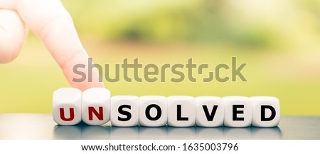 """Hand turns dice and changes the word """"unsolved"""" to """"solved"""". #1635003796"""