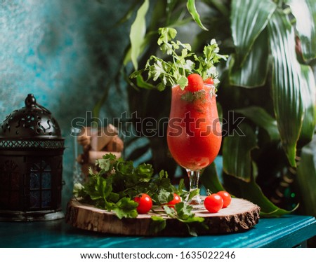 A red cocktail with special decoration #1635022246