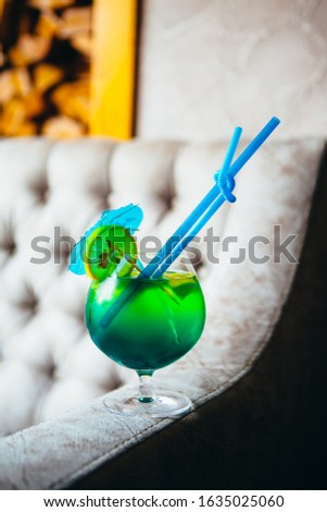 Green decorated cocktail with restaurant background #1635025060