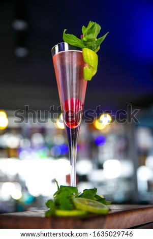Red cocktail with special lemonade decoration #1635029746