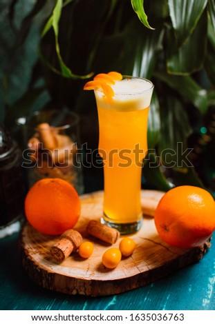 Orange decorated drink with orange #1635036763