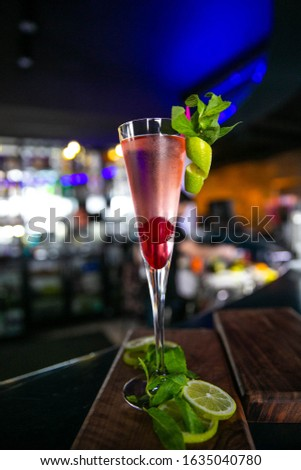 Red colored special drink with restaurant background #1635040780