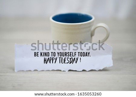 Inspirational quote - Be kind to yourself today. Happy Tuesday. With a cup of morning coffee and a white paper note concept on white wooden table background. Self notes and reminder motivational words #1635053260