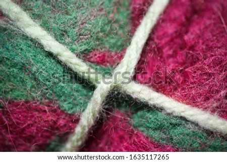 felt material background - felt tied up with string #1635117265