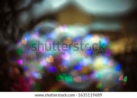 Blur background with glowing colorful hearts bokeh. Defocus abstract romantic shiny wallpaper. Valentine day blurry multicolored lights #1635119689
