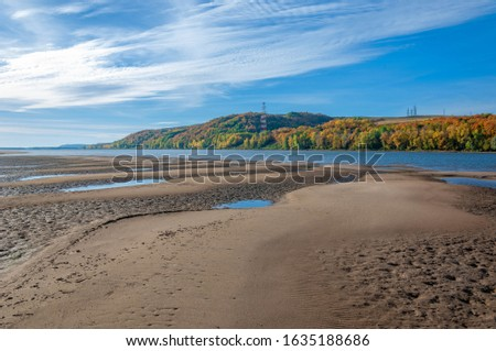 Autumn landscape river sandy shores, rifts and stretches, dark blue cold water, a sad time to catch eyes, a colorful farewell to the summer #1635188686