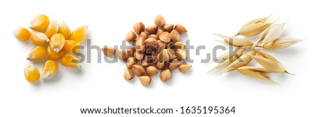 Cereal isolated. Corn, buckwheat, oat grains on white. Heap of seeds top view. #1635195364