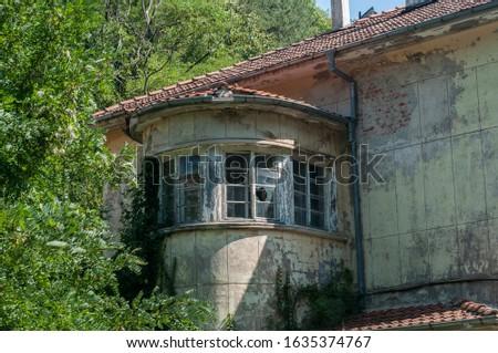 Old obsolete industrial building facade with broken windows #1635374767