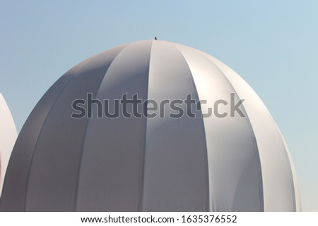 White inflated domes, used as temporary tents. #1635376552
