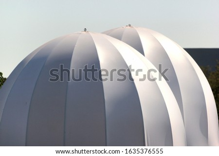 White inflated domes, used as temporary tents #1635376555