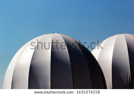 White inflated domes, used as temporary tents. #1635376558
