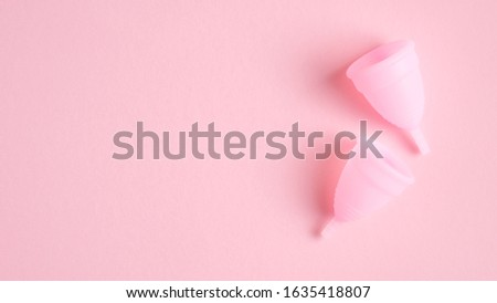 Menstrual cups on pink background. Top view with copy space. Alternative feminine hygiene products. Women health care concept. #1635418807