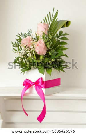Decorative handmade white box with floral arrangement. The floral arrangement consists of three pink roses and green leaves. A wonderful gift for a woman. #1635426196