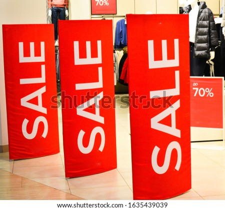 Sale sign.Signboard with the inscription sale in the fashion store. Sale, discounts. Image of a sale ad in a clothing store window/